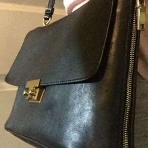 Leather bag, black outside and navy inside